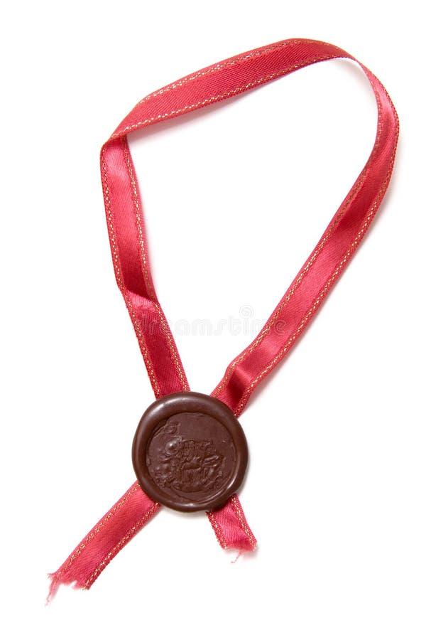 De zegel van het zegelwas met lint royalty-vrije stock afbeelding