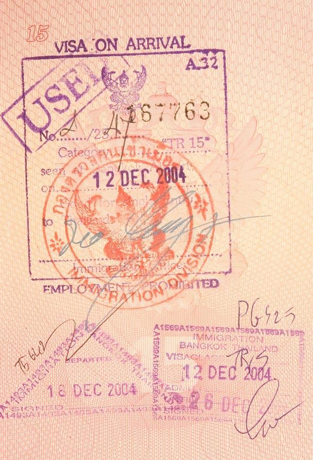 De zegels van het paspoort - visum op aankomst aan Thailand stock afbeeldingen