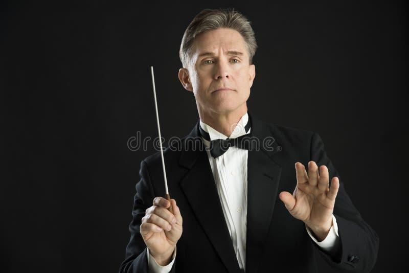 De zekere Knuppel van Directing With His van de Orkestleider royalty-vrije stock foto