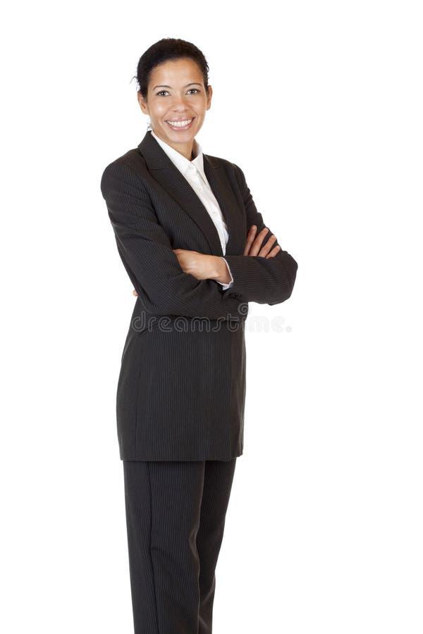 De zelf zekere bedrijfsvrouw glimlacht gelukkig stock afbeeldingen