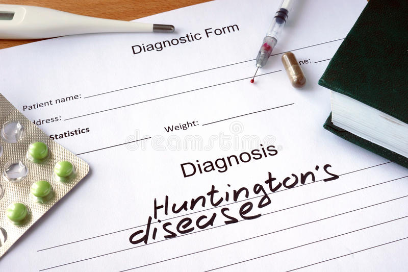 De ziekte en de tabletten van diagnosehuntingtons op een houten lijst royalty-vrije stock afbeeldingen