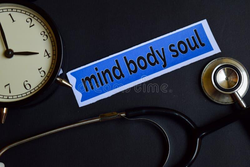 De Ziel van het meningslichaam op het drukdocument met de Inspiratie van het Gezondheidszorgconcept wekker, Zwarte stethoscoop stock afbeelding