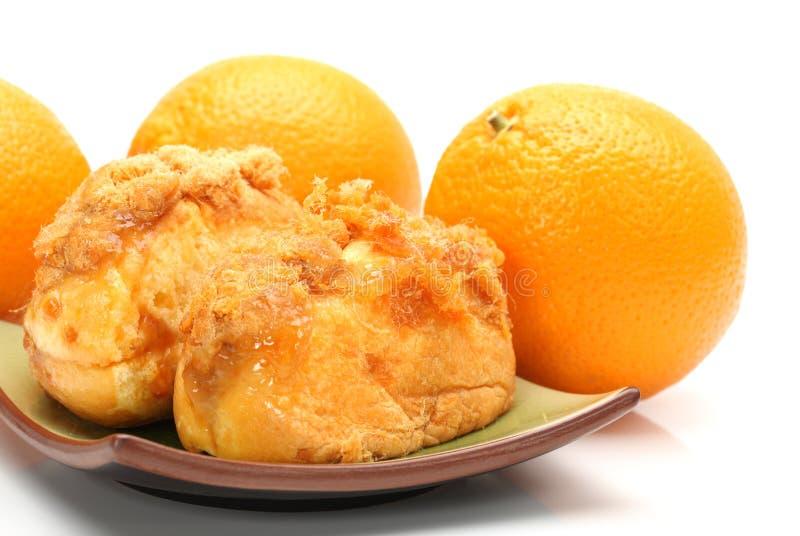 De zijdebroodje en sinaasappel van het varkensvleesvlees stock fotografie