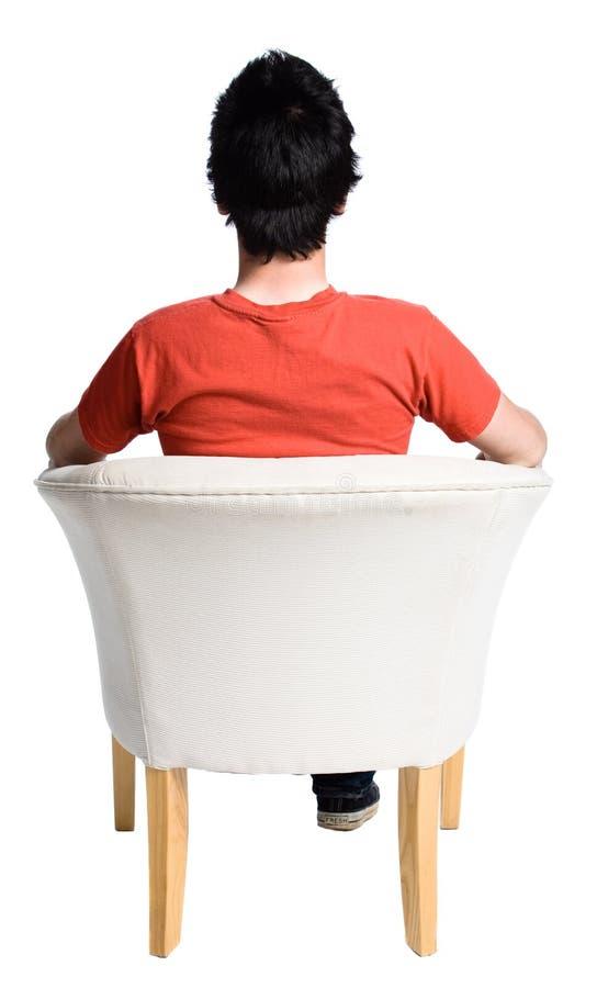 De zitting van de mens op een stoel royalty-vrije stock afbeelding