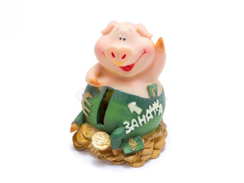 De zitting van het Piggybiggetje op geld royalty-vrije stock foto's