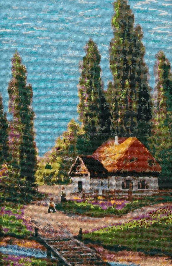 De zomerlandschap met een plattelandshuisje stock foto's