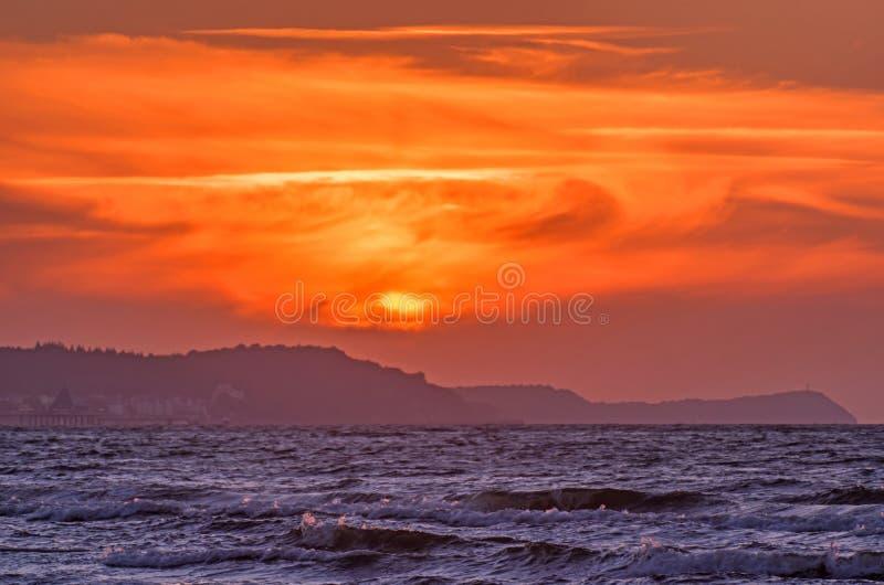 De zon over het overzeese schiereiland stock foto's