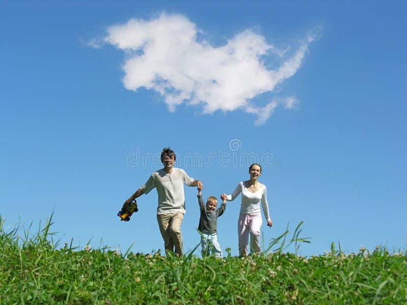 De zonnige dag van de familie royalty-vrije stock foto's