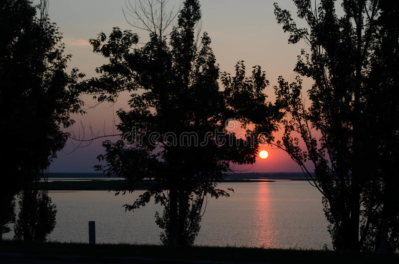 De zonsondergang begin de dag stock fotografie