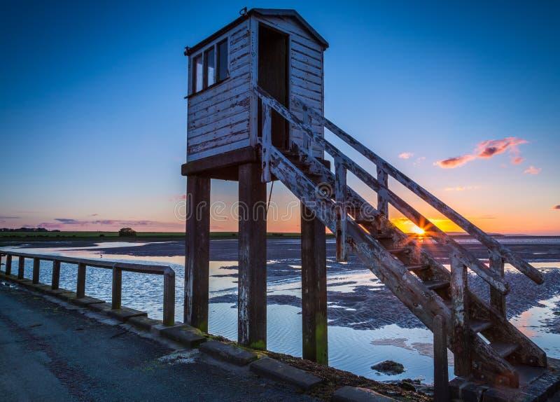 De zonsondergang van de de zomerzonnestilstand op Heilig Eiland stock afbeeldingen