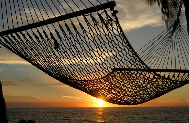 De Zonsondergang van de hangmat stock afbeeldingen