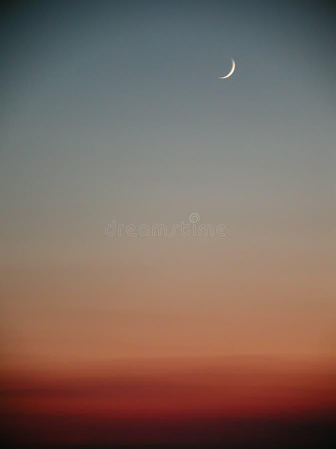 De zonsondergang van de maan stock afbeelding