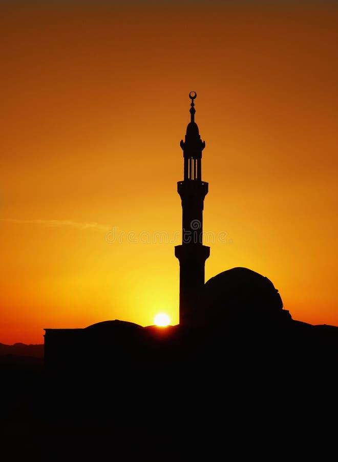 De Zonsondergang van de moskeeminaret stock foto