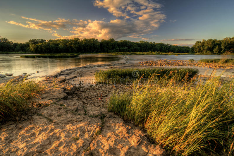 De Zonsondergang van de rivierstroomversnelling royalty-vrije stock fotografie