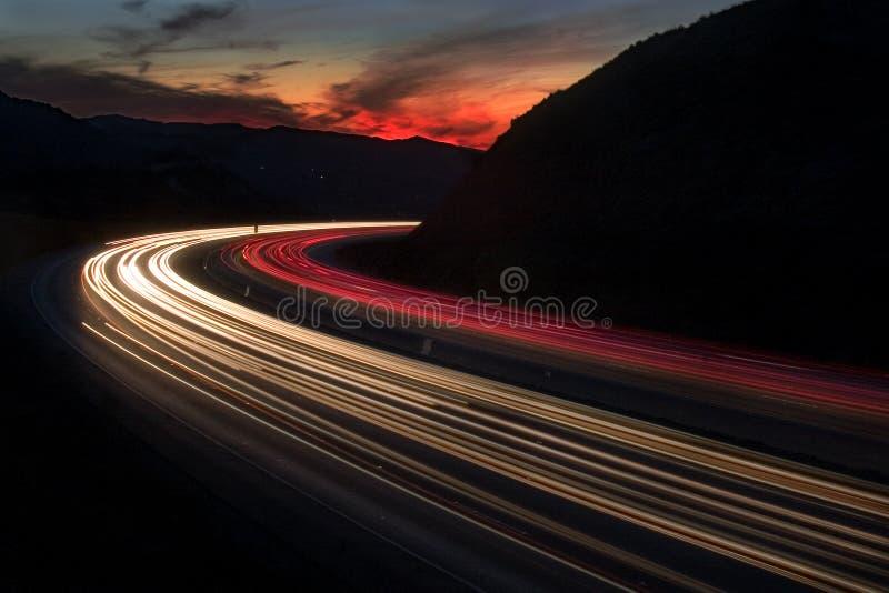 De Zonsondergang van de snelweg royalty-vrije stock foto's