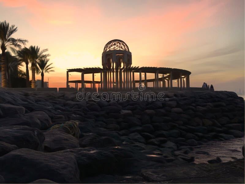 De zonsondergang van Koeweit stock afbeeldingen