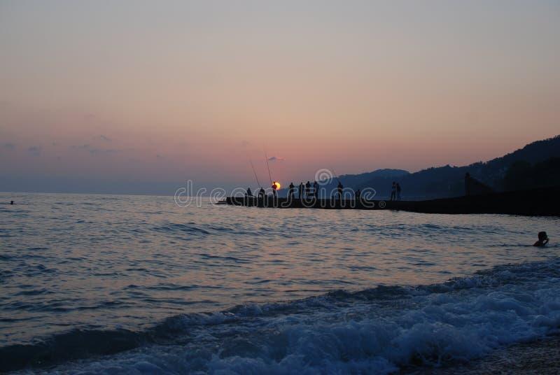 De zonsondergang ziet de zomer stock afbeeldingen