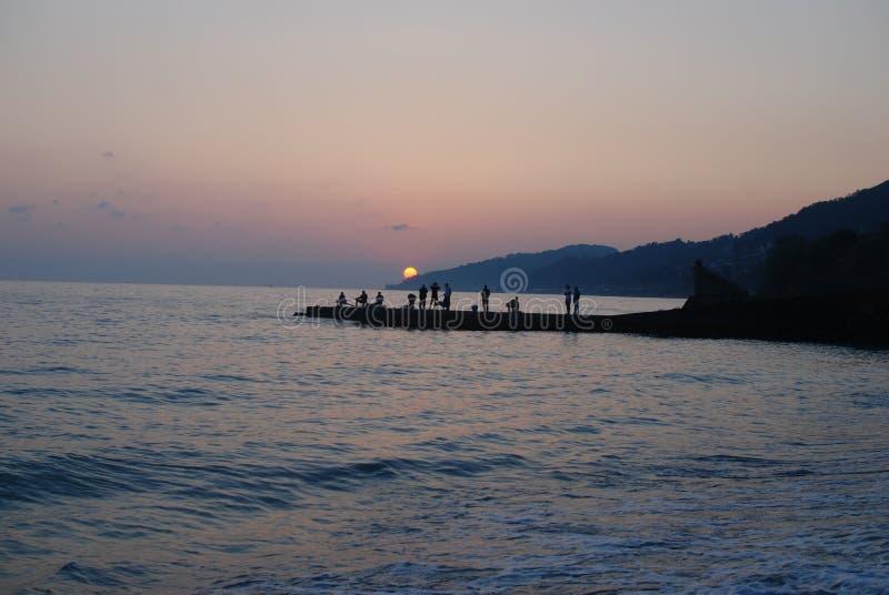 De zonsondergang ziet de zomer stock fotografie