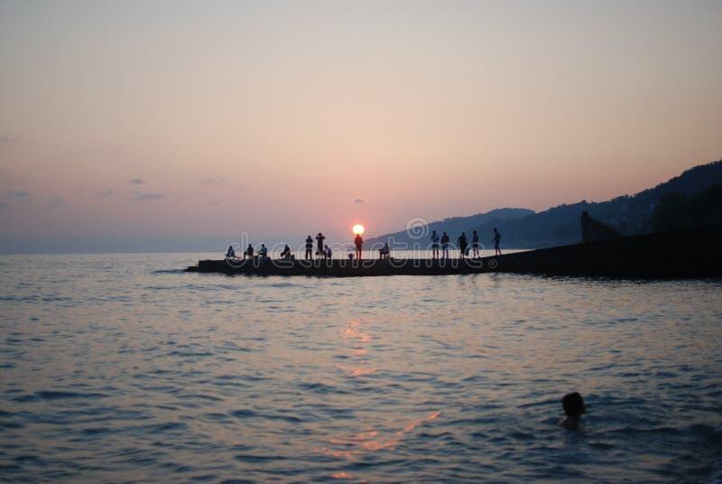 De zonsondergang ziet de zomer stock foto's