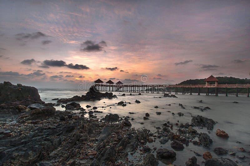 de zonsopgang op strand vult stock afbeeldingen