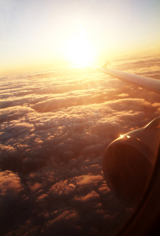 De zonsopgang van het vliegtuig stock afbeeldingen