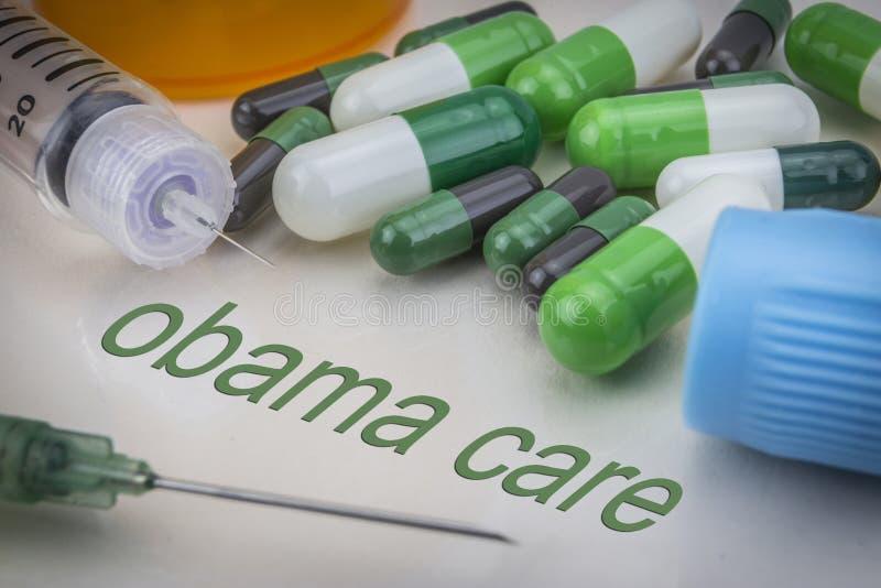 De Zorg, de geneesmiddelen en de spuiten van Obama als concept stock foto's
