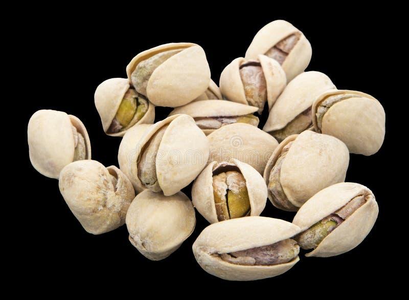 De zoute stapel van de pistaches losse noot isoleerde zwarte royalty-vrije stock afbeelding