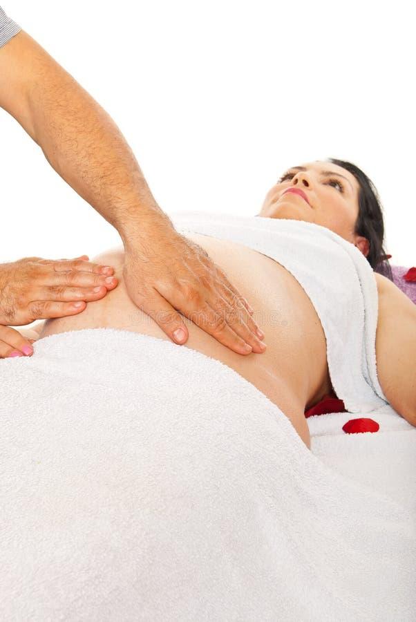 De zwangere massage van de vrouwenbuik stock afbeeldingen