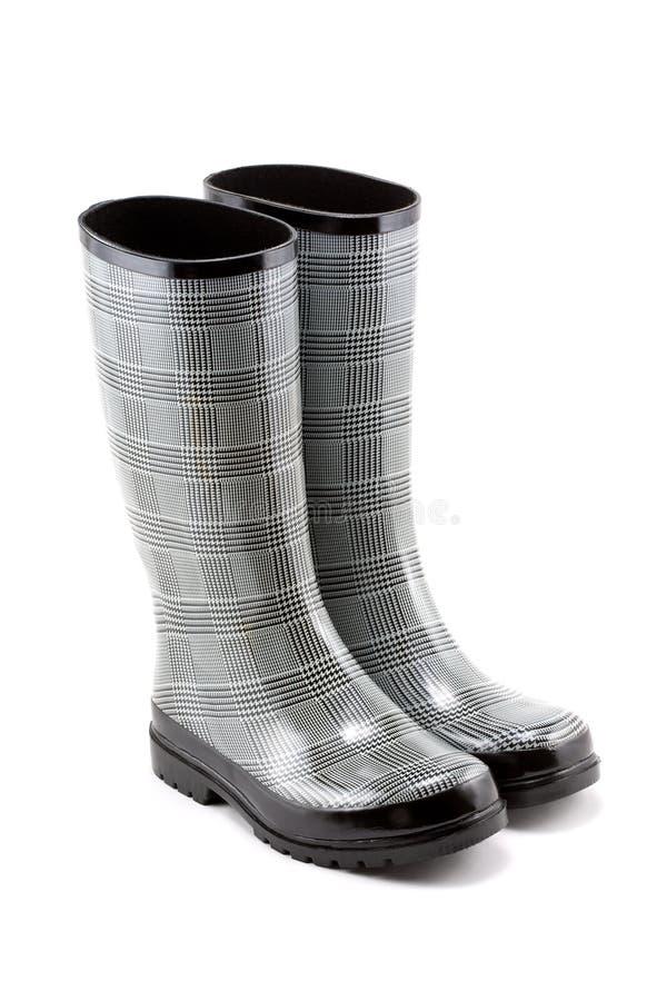 De zwart-witte Laarzen van de Regen van de Visgraat stock fotografie