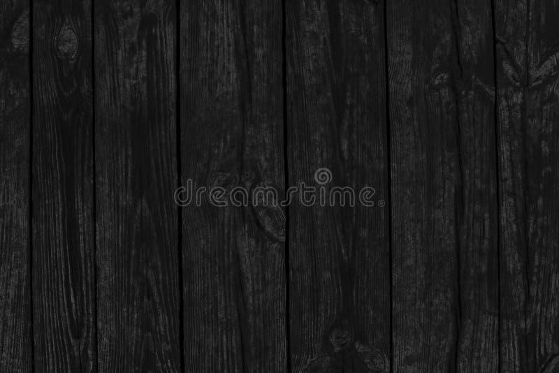 De zwarte achtergrond van burbed houten textuur van oude raad stock fotografie