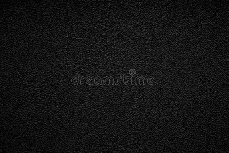 De zwarte achtergrond van de leertextuur stock afbeelding