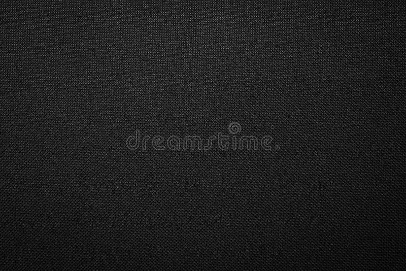 De zwarte achtergrond van de stoffentextuur Donker kledingsmateriaal stock foto's