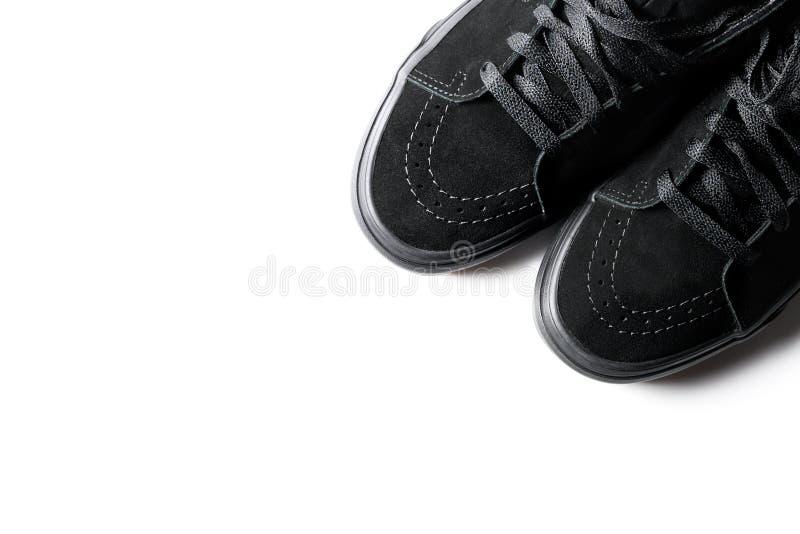 De zwarte die Tennisschoenen van de Sportschoen op witte achtergrond worden geïsoleerd royalty-vrije stock foto