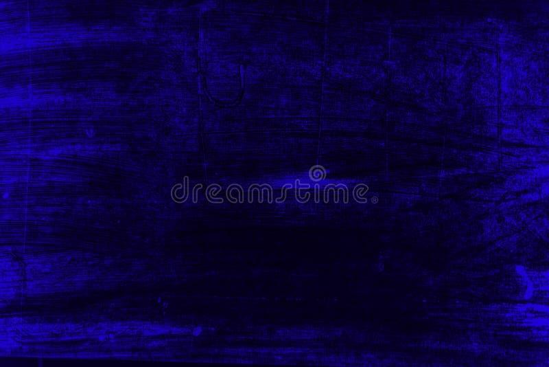 De zwarte en blauwe achtergrond van verfkwaststreken stock foto's