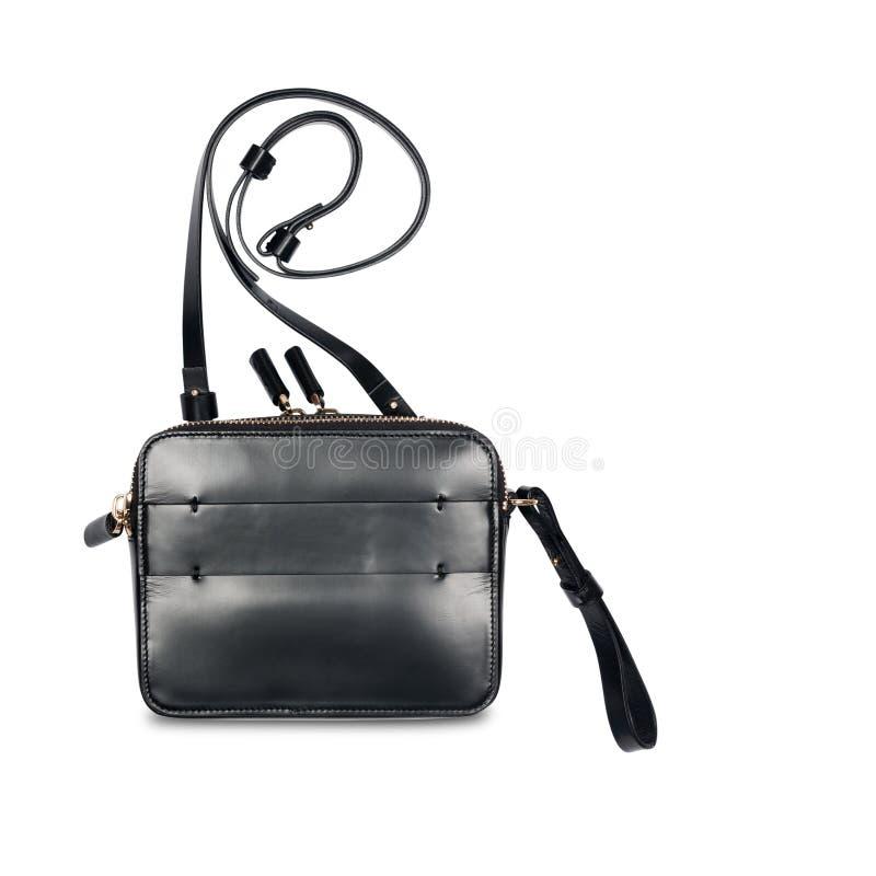 De zwarte geïsoleerde handtas van leerdames stock afbeeldingen