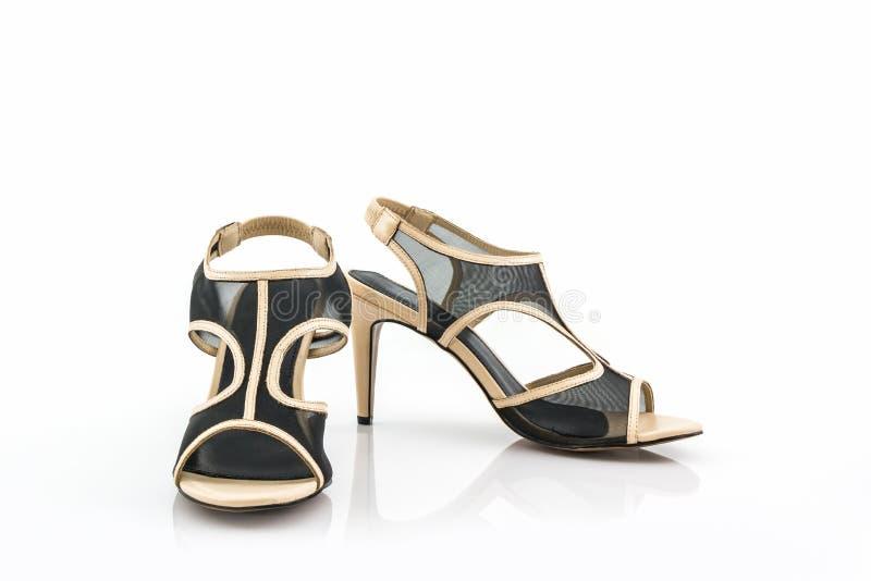 De zwarte hoge schoenen van hielvrouwen stock afbeeldingen
