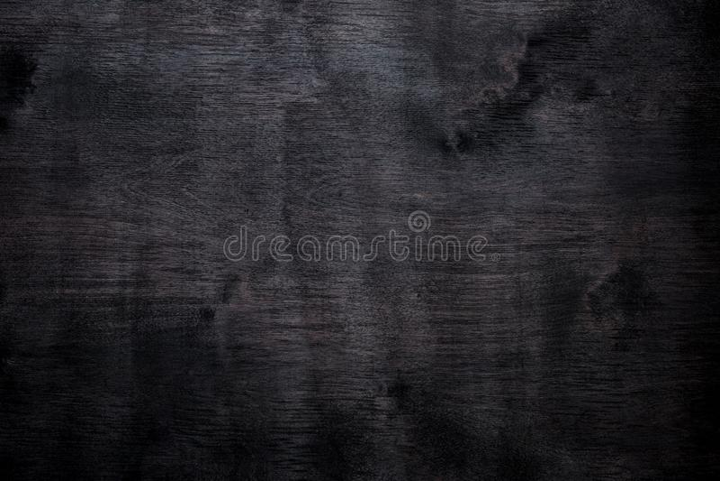 De zwarte houten triplex abstracte achtergrond kleurde vlek stock fotografie