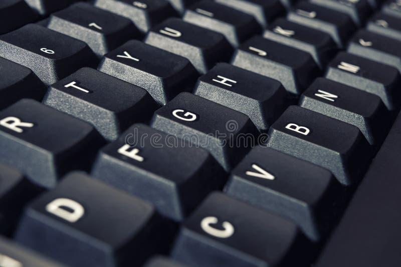 De zwarte knopen van het Computertoetsenbord met Engelse brievenclose-up stock afbeeldingen