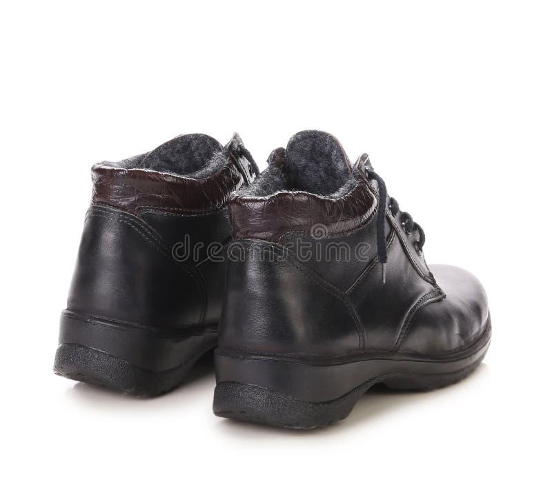 De zwarte laarzen van de sportwinter. stock afbeeldingen