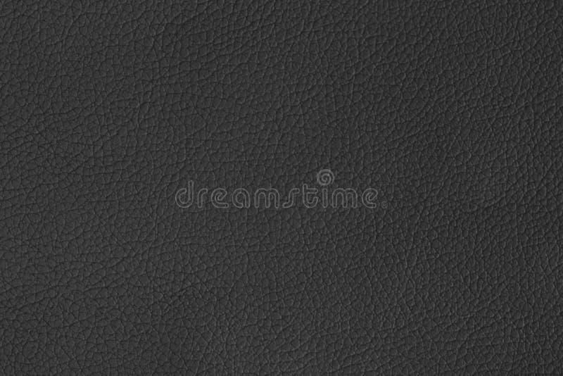 De zwarte leertextuur wordt gebruikt als achtergrond stock foto