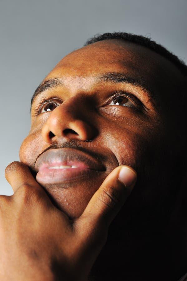 De zwarte mens van de glimlach stock afbeelding