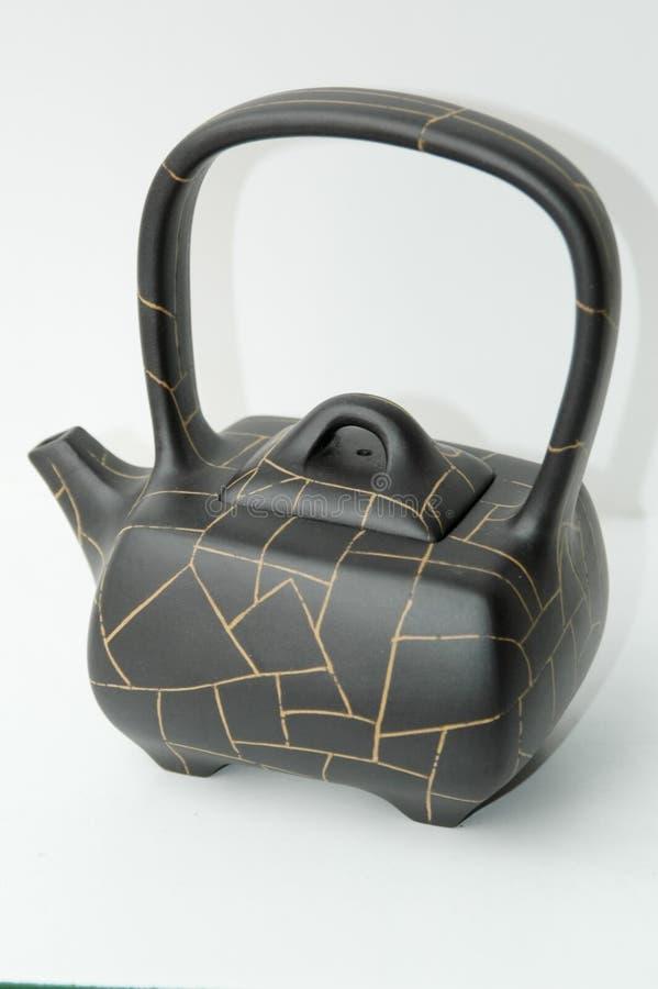 De zwarte pot van de klei Chinese thee stock afbeeldingen