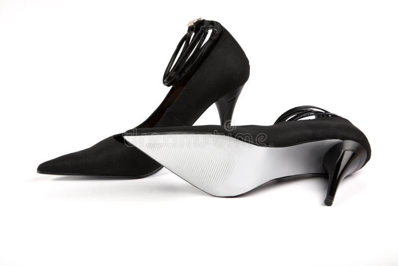 De zwarte schoenen van de vrouw stock foto's