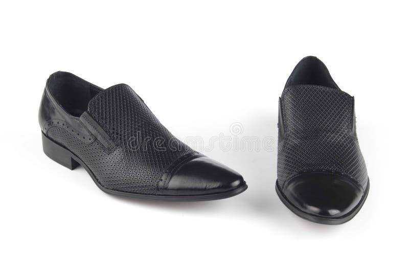 De zwarte schoenen van het kleurenleer stock foto's