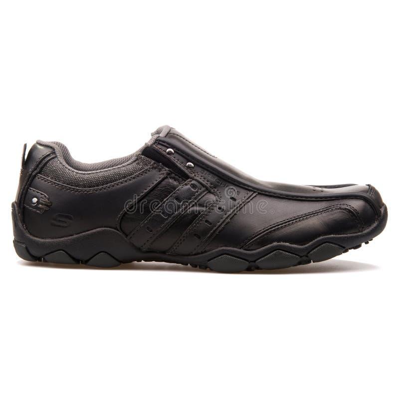 De zwarte tennisschoen van de Skechersdiameter stock foto's