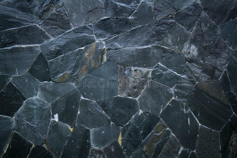De zwarte textuur van het steenpatroon stock afbeeldingen