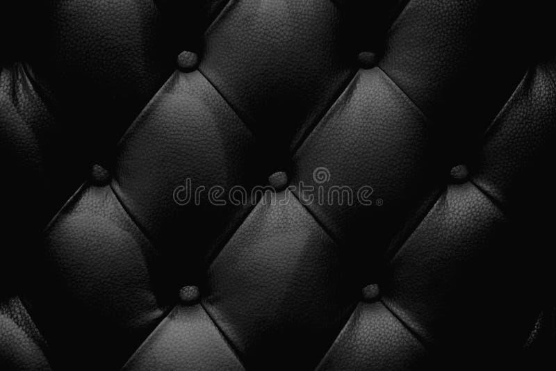 De zwarte textuur van de leerbank stock afbeeldingen