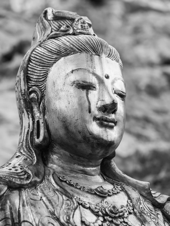 Dea gridante monocromatica della statua di pietà (Quan Yin, Kuan Yim, immagini stock libere da diritti