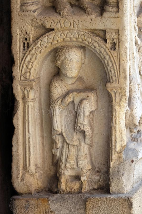 Deacon, bass relief, Modena Cathedral, Italy stock photography