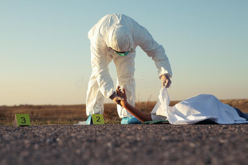 Dead body after murder at the scene after forensics by the police. Old Dead body after murder at the scene after forensics by the police royalty free stock images